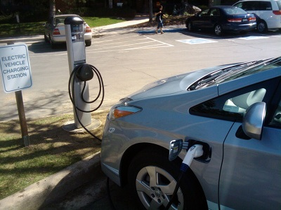 NREL DOE image - Electric Vehicle charging at a charging station